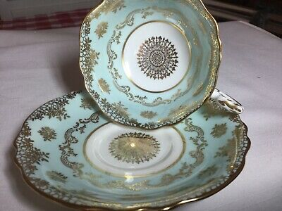Paragon Bone China Cup/ Saucer.  England   Dw  Pale Blue/Gold Scrolling