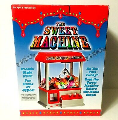 The Claw Electronic Candy Dispenser Toy The Sweet Machine Arcade Game w/ Music