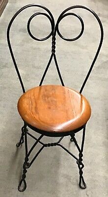 Wrought Iron Ice Cream Parlor Chair  Twisted wrought iron chair with wood seat.