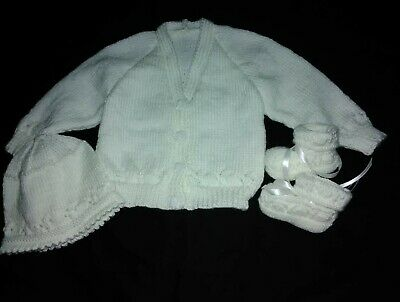hand knitted white diamond pattern on edg matching cap and booties