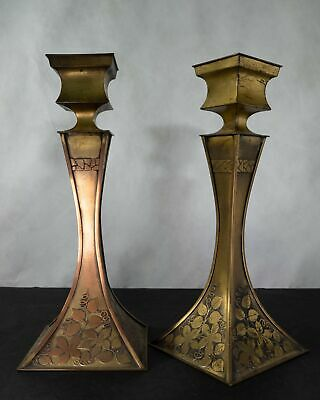 Pair of Arts & Craft candlesticks with foliage pattern