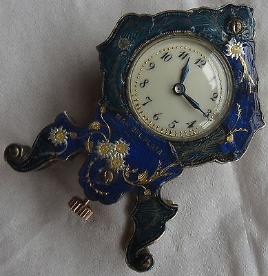 Vintage enamel & bronze small clock load manual 34 mm. x 51 mm. aside