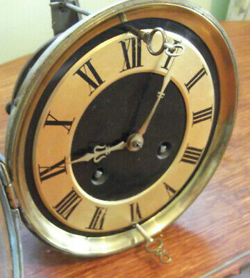 Antique unusual B.R clock movement , pendulum and key