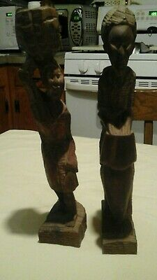 handcarved wooden statues man/woman african/haiti