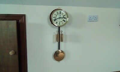 Complete late 19th century gustav becker wall clock movement and dial,