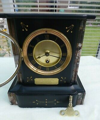 Slate cased mantle clock of small proportion Claire college Rotherhite 1889