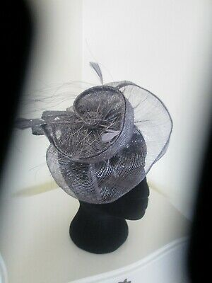 Silver/Grey sinamay hatinator/fascinator with feather embellishment for weddings