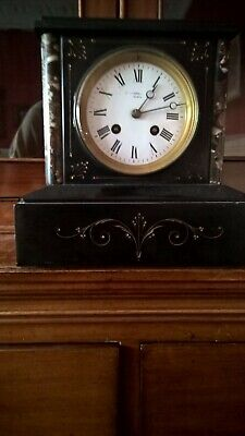 Antique marble surround clock. Not working but all there, key missing.