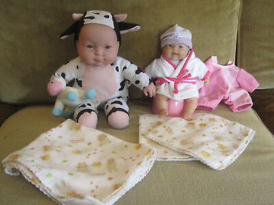 Berenguer 2 soft body baby dolls, 30 cm, 20 cm, one with cow suit, potty