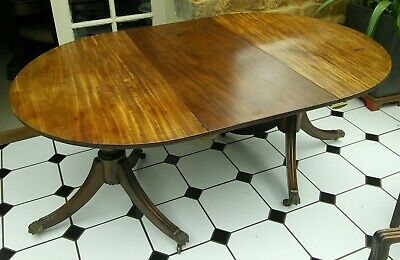 Antique twin pedestal D end mahogany dining table with leaf