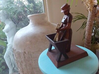 Lovely old hand carved wooden  lady with a wash board