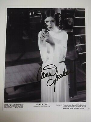 """Carrie Fisher  Signed """"Princess Leia""""  Holding Gun"""