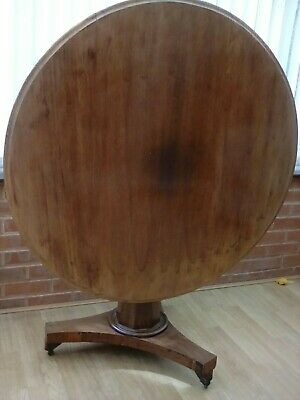 Antique round tip top table seats 4 people.