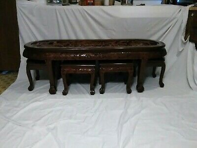 Chinese Oval Coffee or Tea Table With Handcarved Battle Scene And Six Stools