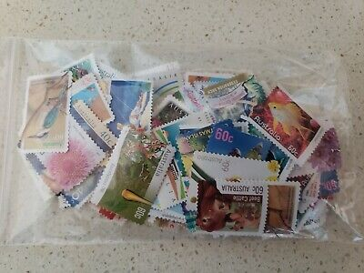 Unfranked Stamps OFF PAPER. Mixed.  FV $100 .