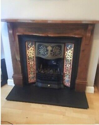 Victorian style cast iron fireplace with lilly tiles