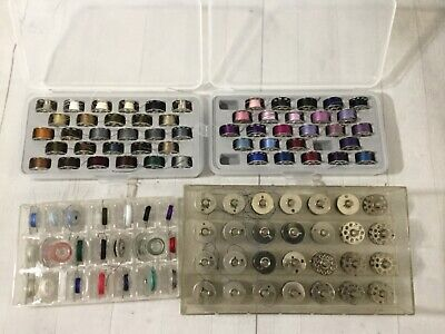 Lot of metal & plastic sewing bobbins with case