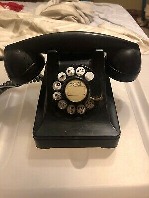 vintage bakelite phone black - Wired to work in your home