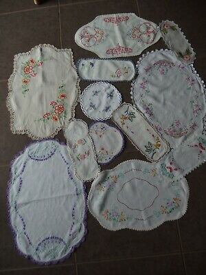 12 VINTAGE HAND EMBROIDED DOILIES..Mix  of large and small