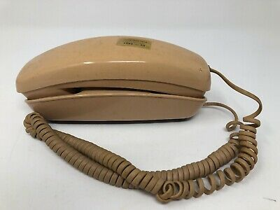 Vintage Western Electric Trimline desk telephone. Rotary dial. Tan brown beige