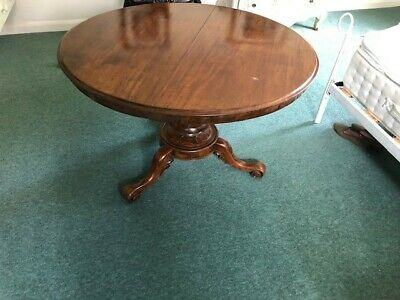 Antique mahogany circular dining table