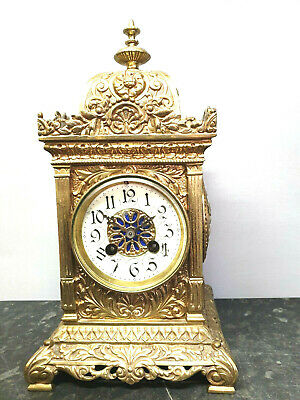 Antique Brass 8 Day Bracket /Table Clock with a Marti of Paris movement.