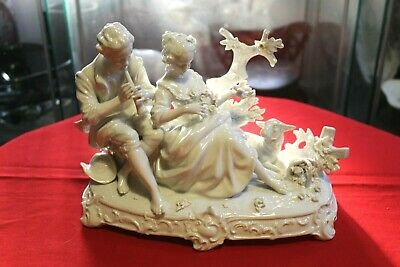 Collectible old European porcelain white figurine, couple in nature.
