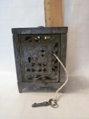 antique 1886 cast iron safe still bank with key penny register savings