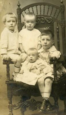 AT48 Vintage Photo RPPC CARVED CHAIR, FOUR CHILDREN c Early 1900's