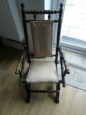 A child's late Victorian walnut ring turned frame rocking chair,