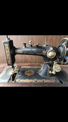Treadle Sewing Machine in Cabinet Antique