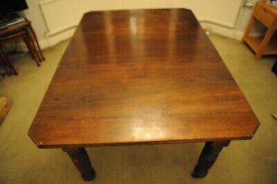 Antique, Victorian extending dining table with one leaf, turned legs, castors