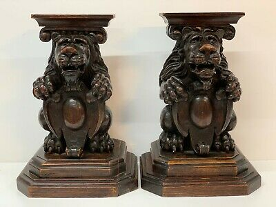 Antique  Hand Carved Walnut Stands Pair Seated Lions  Holding Armorials Shelves