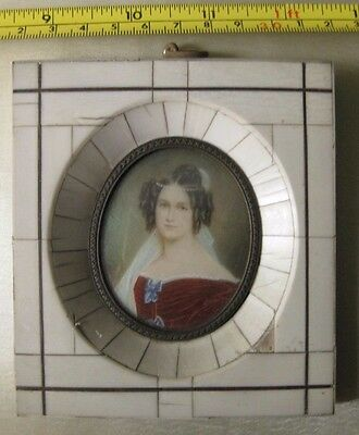 Very beautiful hand painted miniature of a young lady, nicely framed.
