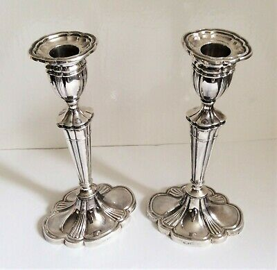 Pair of  Georgian Adams style sterling silver candle sticks