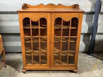 Antique glazed solid oak double door bookcase display cabinet with gallery top