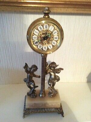 ESTYMA Antique Mantel Clock/Alarm Clock on Onyx Base with two Cherubs. Excellent