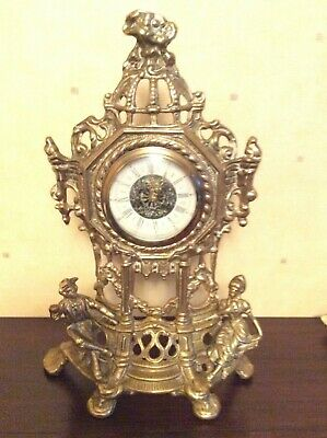 Vintage Ornamental Brass Mantel Clock. Very decorative with brass figurines.