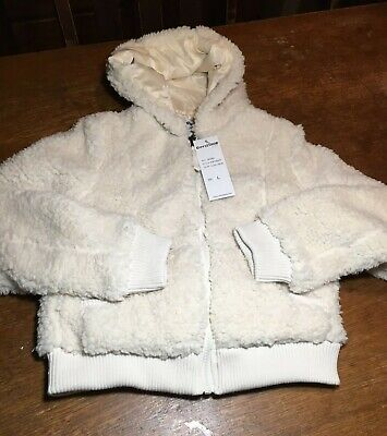 girls fleece jacket size   (10-12) cream colored zip front w/ pockets and hood,