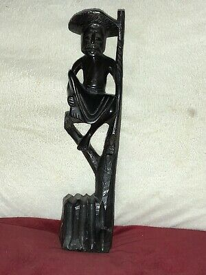 Vintage Carved Black Wooden Figure of an Oriental Man Seated on a Branch