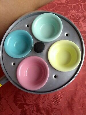 vintage 4 egg poacher with colourful cups which 2 are marked govancroft