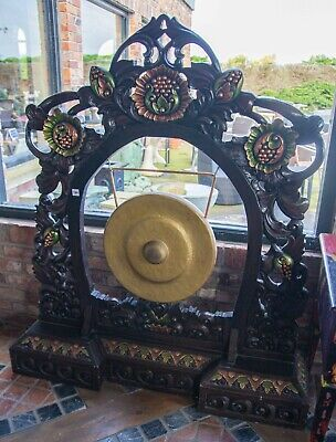 A Large Carved Wood Polychrome And Brass Gong,