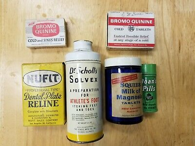 Assortment of antique medical bottles, tins and boxes