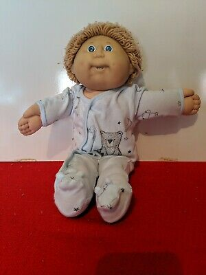 CPK Boy Cabbage Patch Kid. In a baby jumpsuit. Light brown hair.