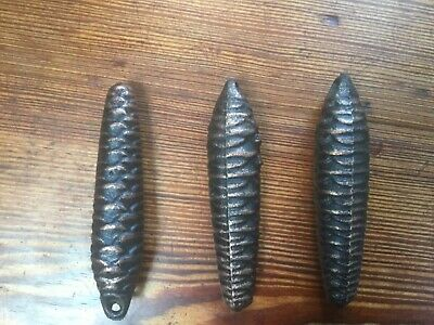 Three iron cuckoo clock weights, pine cone shaped, 350 grammes each