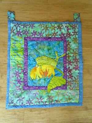 Green Frog Day Dreaming On A Flower Wall Hanging. 49Cms High X 43Cms Wide.