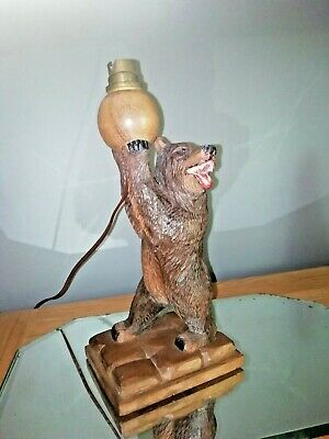 Antique German carved wooden bear lamp. of the Black Forest