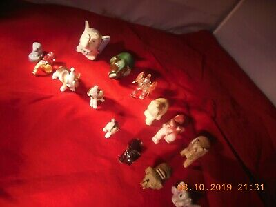 Lot of fourteen small elephants