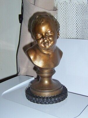 Antique Cast Metal Bust of a baby laughing 8 1/2 inch