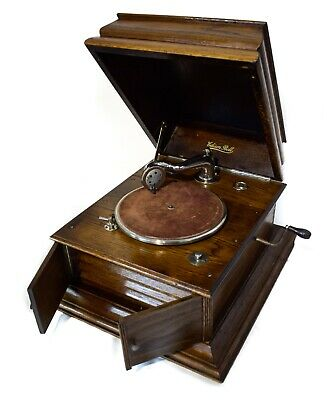 Edison Bell grand table gramophone in oak case + album + 10 records